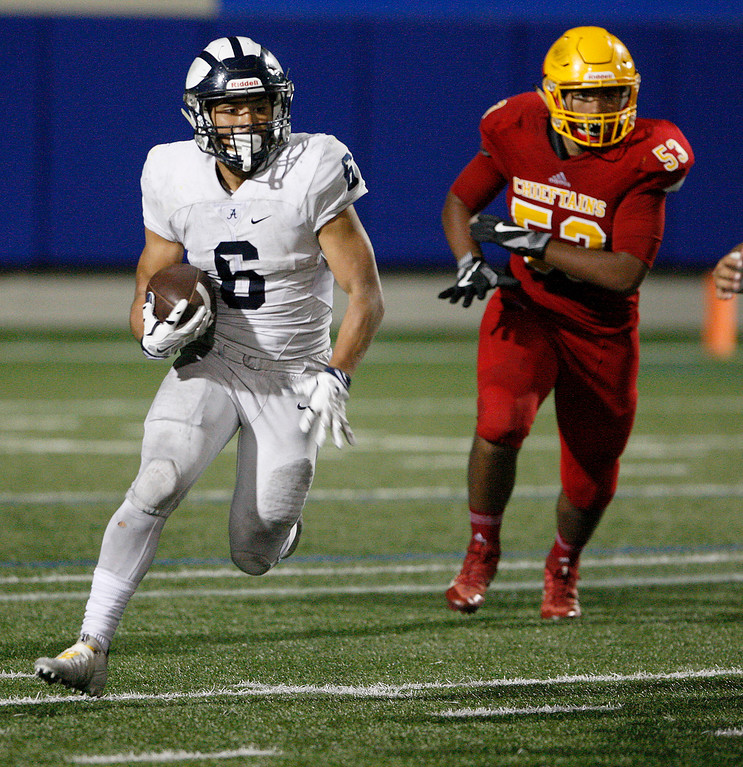 . Aptos running back Marcos Reyes (6) runs for yards in the second half of their game against Palma at Rabobank Stadium in Salinas on Friday, Sept. 22, 2017.  (Vern Fisher - Monterey Herald)