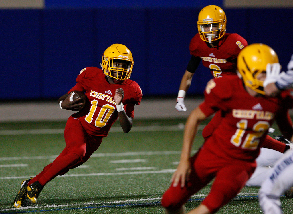 . Palma\'s Jon-Jon Berring (10) runs for yards in the first half of their game against Aptos at Rabobank Stadium in Salinas on Friday, Sept. 22, 2017.  (Vern Fisher - Monterey Herald)