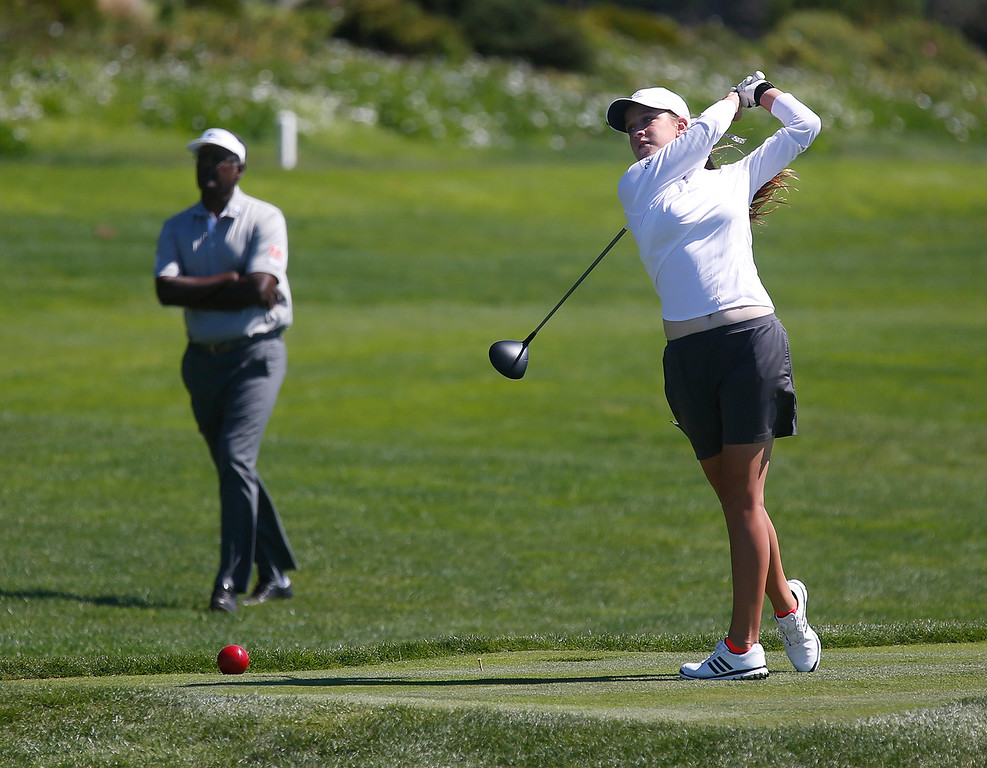 . Juior golfer Katie Harris tees off on the 14th hole as her PGA Tour Champions partner Vijay Singh watches during the final round of the Pure Insurance Championship Impacting The First Tee at Pebble Beach Golf Links in Pebble Beach on Sunday September 24, 2017.(David Royal/Herald Correspondent)