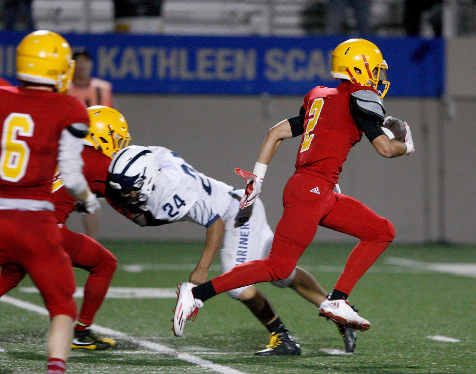 . Palma\'s Mateo Martinez (2) runs for yards in the first half of their game against Aptos at Rabobank Stadium in Salinas on Friday, Sept. 22, 2017.  (Vern Fisher - Monterey Herald)