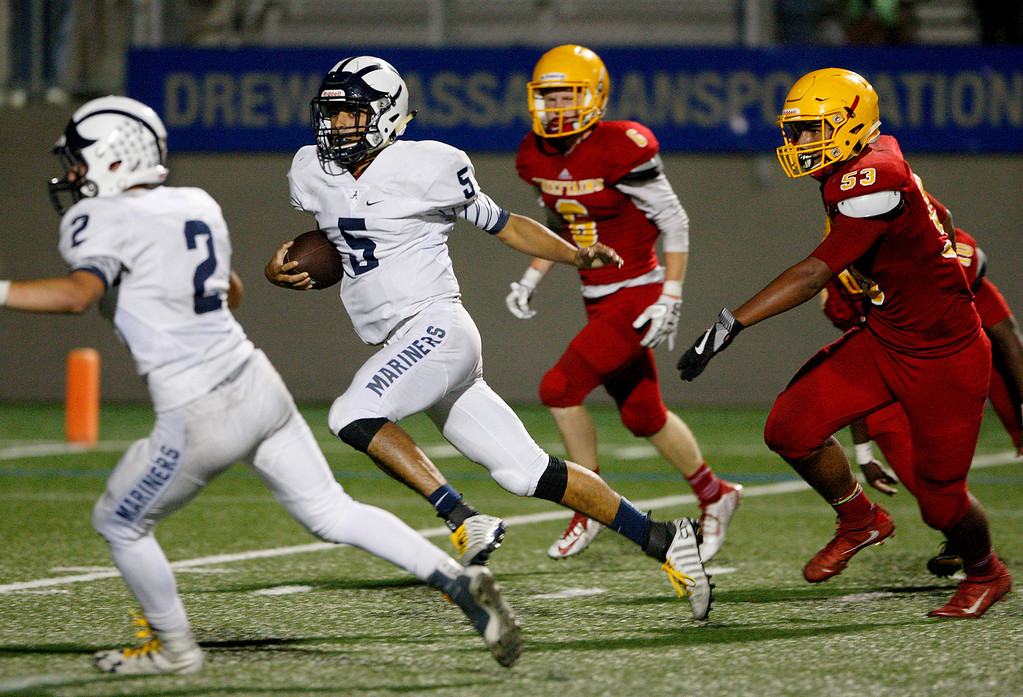 . Aptos\' Hunter Matys (5) runs for a touchdown in the second half of their game against Palma at Rabobank Stadium in Salinas on Friday, Sept. 22, 2017.  Aptos beat Palma 35-13.  (Vern Fisher - Monterey Herald)