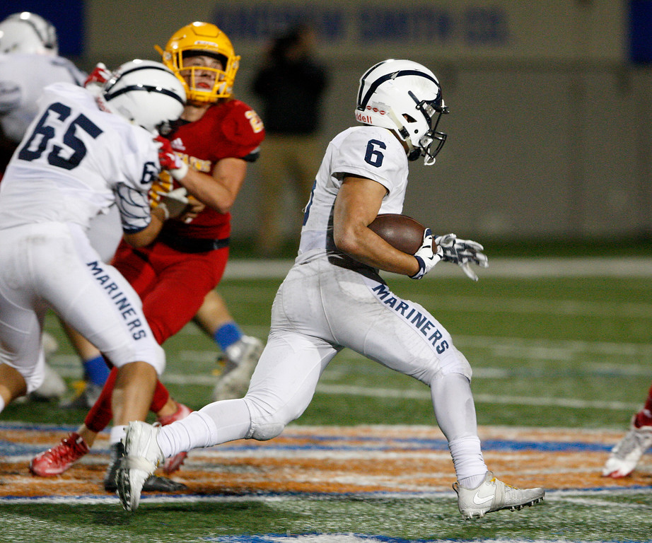 . Aptos\' Marcos Reyes (6) finds open field running in the first half of their game against Palma at Rabobank Stadium in Salinas on Friday, Sept. 22, 2017.  (Vern Fisher - Monterey Herald)