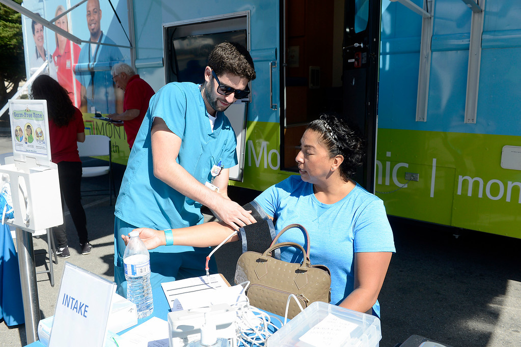 . Nurse Jameel Sughair checks the vitals of Sylvia Bailey at the Montage Health mobile clinic in Seaside on Thursday, Sept. 28, 2017.  (Vern Fisher - Monterey Herald)