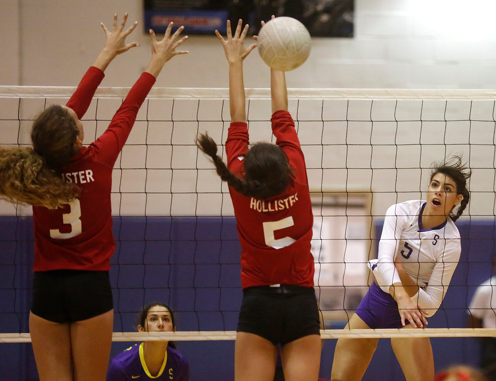 . Salinas\' Taylor Rose spikes the ball against Hollister during girls volleyball at Salinas High School on Tuesday September 26, 2017. (David Royal/Herald Correspondent)
