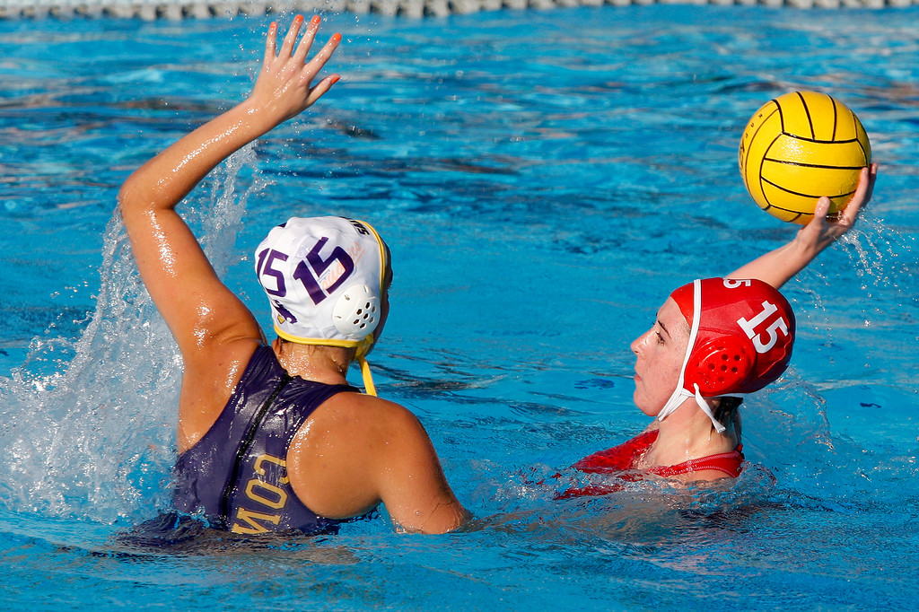 . Salinas\' Miranda Wilson (15) plays tough defense against Carmel\'s Kelly Rice (15) during their game in Carmel on Thursday, Sept. 28, 2017.  (Vern Fisher - Monterey Herald)
