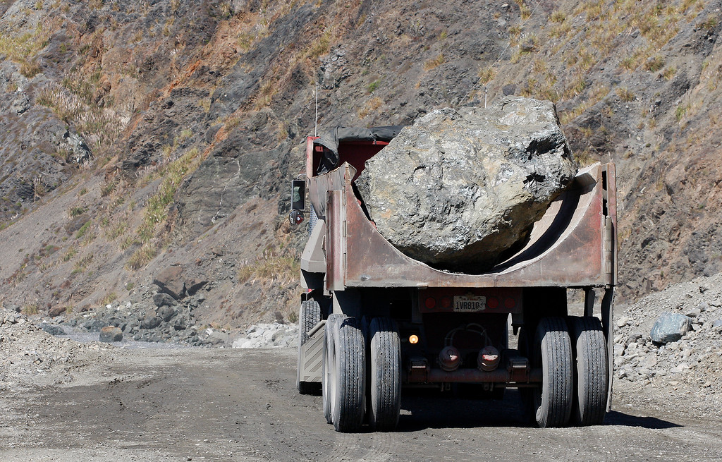 . Large boulders being trucked as part of the effort to fix and repair the Mud Creek Slide in southern Monterey County on Highway One on Thursday, Sept. 21, 2017.   (Vern Fisher - Monterey Herald)