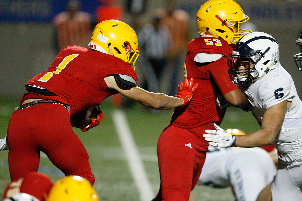 . Palma\'s Anthony Villlegas (1) runs for yards behind the blocking of Palma\'s Michael Lizaola (53) in the first half of their game against Aptos at Rabobank Stadium in Salinas on Friday, Sept. 22, 2017.  (Vern Fisher - Monterey Herald)