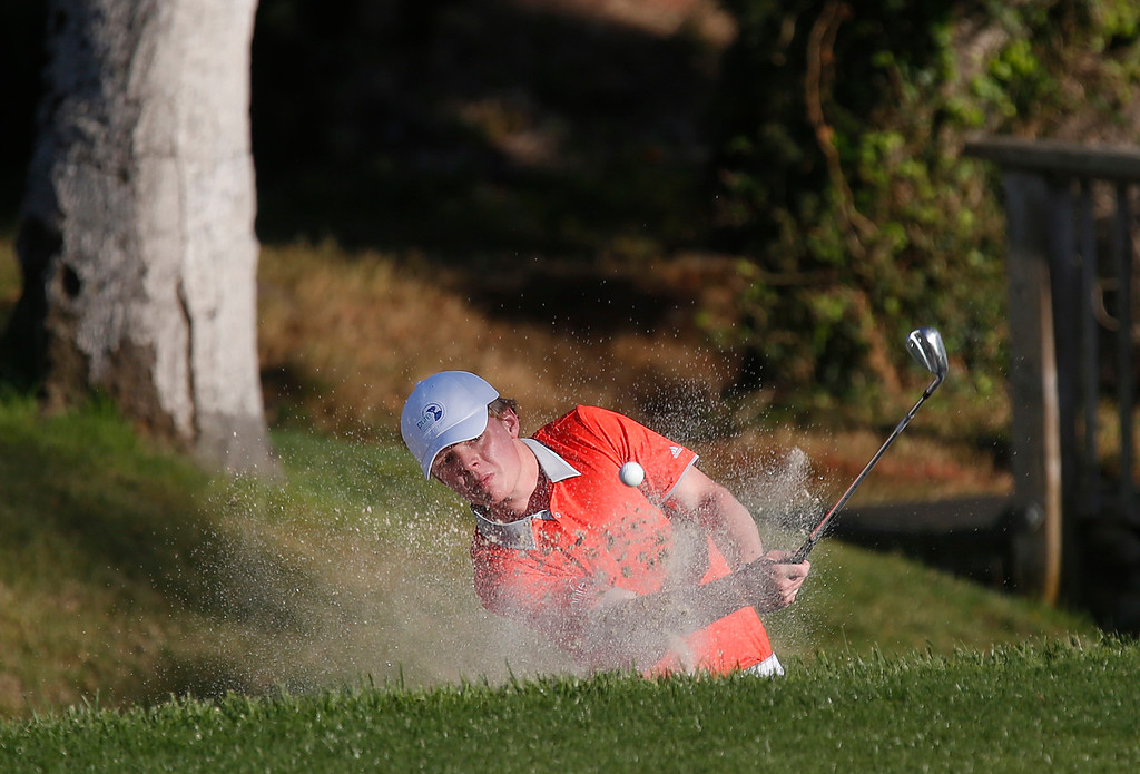 . Junior Golfer Justin Potwora of the First Tee of Greater Portland hits his ball from a trap on the 16th hole during the final round of the Pure Insurance Championship Impacting The First Tee at Pebble Beach Golf Links in Pebble Beach on Sunday September 24, 2017.(David Royal/Herald Correspondent)