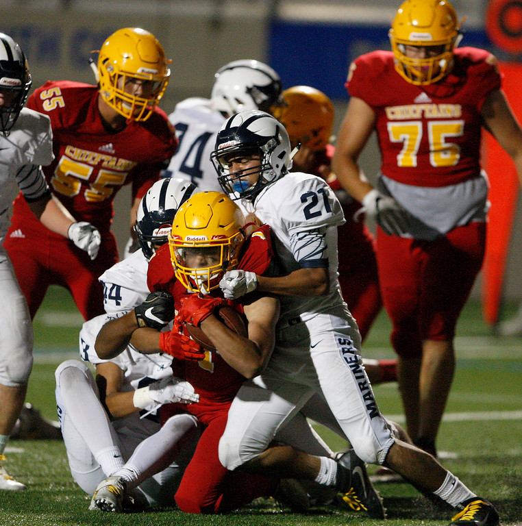 . Palma\'s Anthony Villlegas (1) gets tackled by Aptos\' Edward Franco (21) in the first half of their game against Aptos at Rabobank Stadium in Salinas on Friday, Sept. 22, 2017.  (Vern Fisher - Monterey Herald)