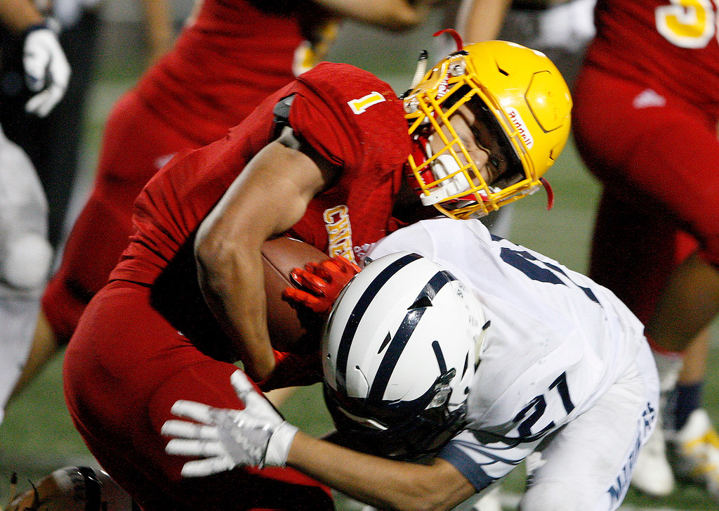. Aptos\' Edward Franco (21) puts a hit on Palma\'s Anthony Villegas (1) in the second half of their game against at Rabobank Stadium in Salinas on Friday, Sept. 22, 2017.  Aptos beat Palma 35-13.  (Vern Fisher - Monterey Herald)