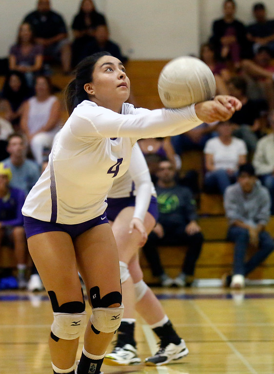 . Salinas\' Jovi Marinelli digs against Hollister during girls volleyball at Salinas High School on Tuesday September 26, 2017. (David Royal/Herald Correspondent)