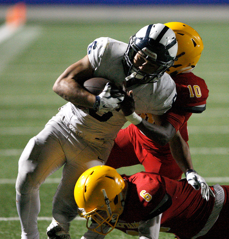 . Aptos running back Marcos Reyes (6) battles Palma\'s Dominic Scattini (6) and Jon-Jon Berring (10) for yards in the second half of their game against Palma at Rabobank Stadium in Salinas on Friday, Sept. 22, 2017.  (Vern Fisher - Monterey Herald)