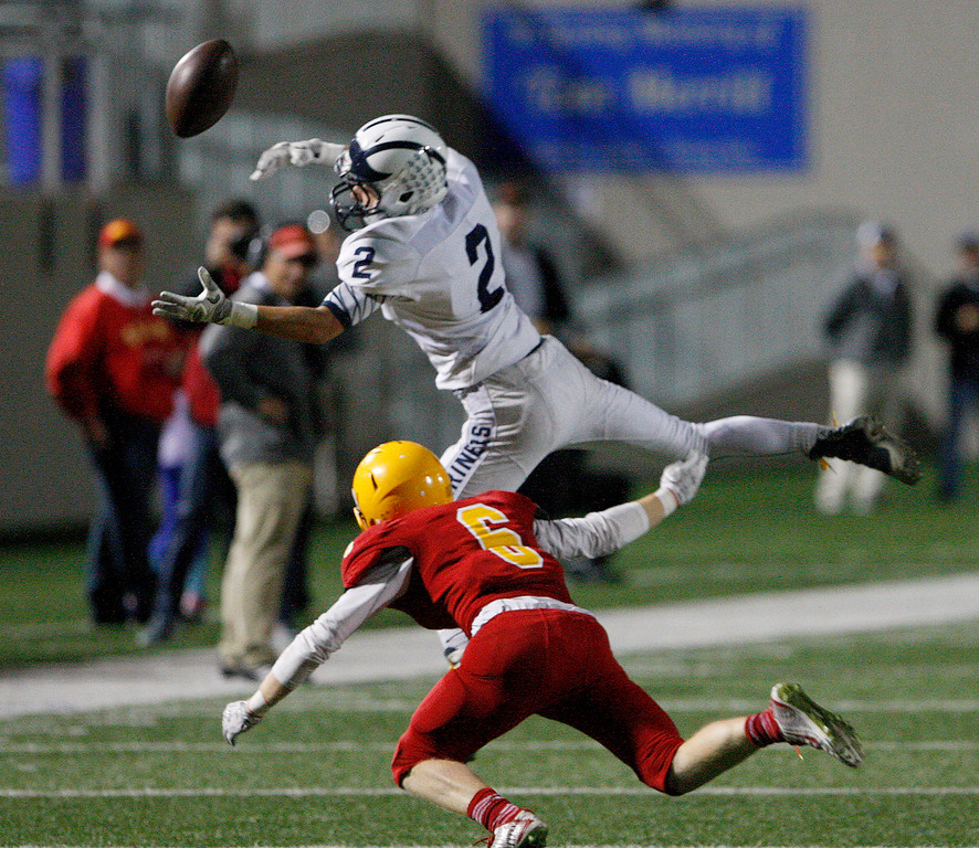 . Aptos\' Blake Wheeler (2) fails to catch a pass as Palma\'s Domonic Scattini (6) applies the defense in the first half of their game against Aptos at Rabobank Stadium in Salinas on Friday, Sept. 22, 2017.  (Vern Fisher - Monterey Herald)