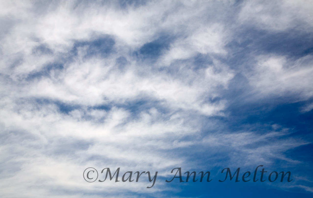 Title:  Cloud Faces<br /> Hutto, Texas