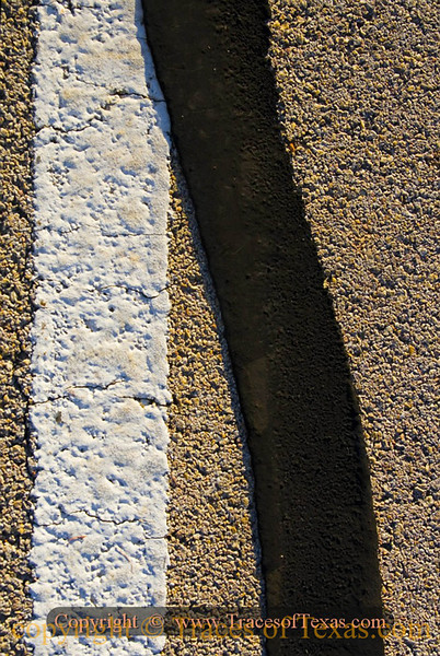 Title:   What I saw in Noodle, Texas<br /> <br /> Comments: There are hundreds of thousands of miles of highway stripes in Texas, but I think that this one is the nicest.<br /> <br /> Location:  Noodle, Texas