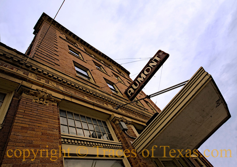 Title:  Just Hanging Around<br /> <br /> Comments: The Aumont still stands tall after almost 100 years. I love this building and am hoping for another 100. <br /> <br /> Location: Seguin