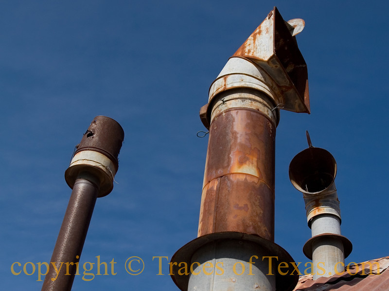 Title: On Top of Old Smokey<br /> <br /> Comments:  Why this falling-down house in west Texas needed three vents above the kitchen will probably never be known, but I thought they made a nice abstract against that blue sky. <br /> <br /> Location: Orla