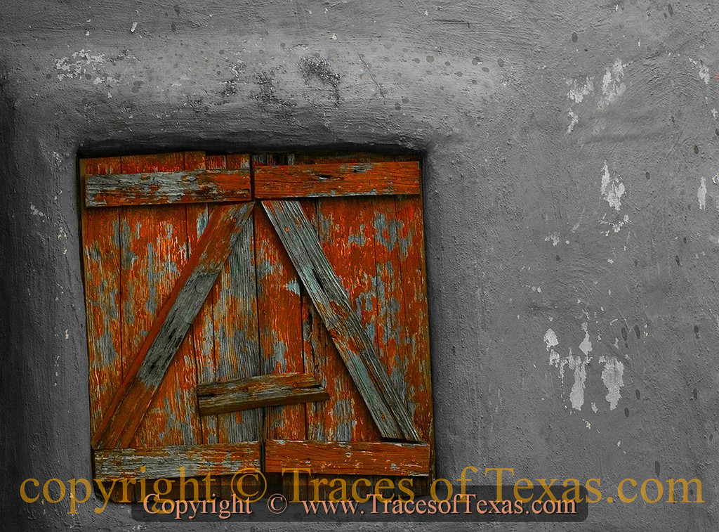 Title:   Color My Window<br /> <br /> Comments: West Texas doesn't really need too much in the way of glass windows, so we make do with wooden ones.<br /> <br /> Location: Brackettville, Texas