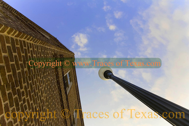 Title:   228 Miles from Home<br /> <br /> Comments: Study in geometrical angles and sky.<br /> <br /> Location: Downtown Nacogdoches, Texas