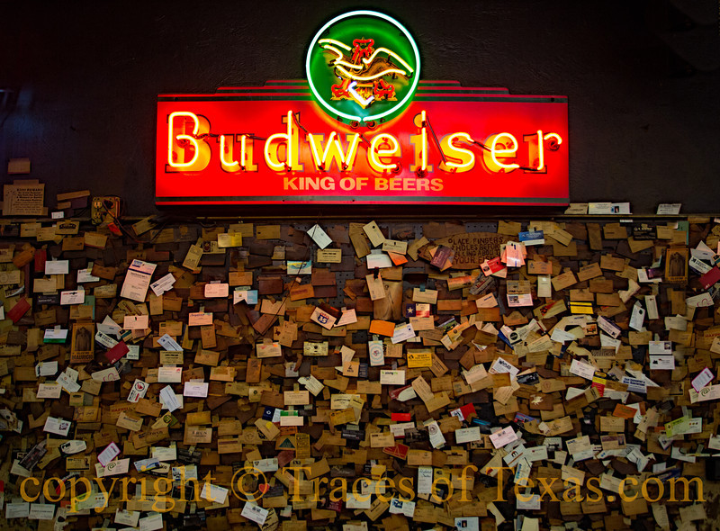 Title:   Taking a Shellacking<br /> <br /> Comments: Thousands of business cards have been left over the years on the wall at Louis Mueller BBQ in Taylor.  They pretty much all start out white, but turn browner and browner over time as that wonderful smoke gets to them. <br /> <br /> Location:  Taylor