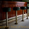 Title: Stool Life<br /> <br /> Comments: The four stools in the lobby of the Aumont in Seguin have been seating folks comfortably since 1916.  We should all look this good at the age of 96!<br /> <br /> Location: Seguin