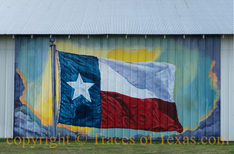 Colorful depiction of the Texas Lone Star flag in a mural on a building in Terrell, Texas, east of Dallas.