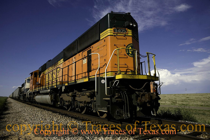 Title:   If You've Ever Felt a Locomotive Shake the Ground<br /> <br /> Comments: If you've ever lived in a small Texas town, you know that it is a dark thrill to stand close to a locomotive as it is passing. <br /> <br /> Location: Channing, Texas