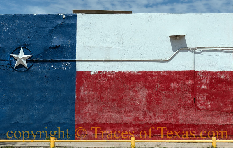 A wall colorfully painted with the likeness of the Texas flag, complete with a 3-D star, in the little town of Asherton in Dimmit County, Texas.