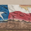 Now-incomplete depiction of a Texas flag on a building in Van Horn, Texas.