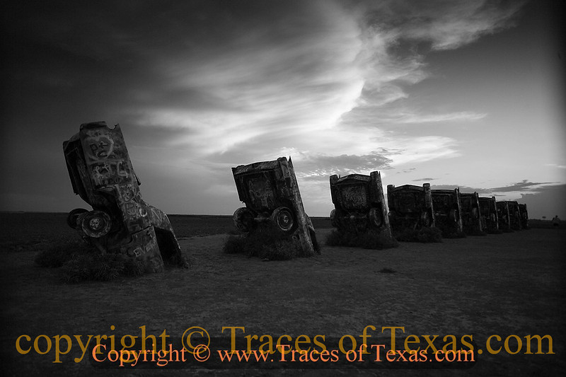 Title:   Amarillo Stonehenge 1<br /> <br /> Comments: I did all I could to resist stopping at the Cadillac Ranch when I passed it.  As you can see, I failed.<br /> <br /> Location: Amarillo, Texas