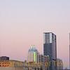 Austin skyline with power plant light illuminated.