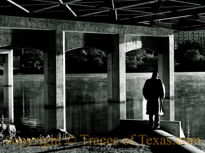 "Title:  'Cos there's something in a Sunday ...... Makes a body feel alone<br /> <br /> Comments:  Ironically, I were playing Kris Kristofferson's version of ""Sunday Morning Coming Down"" on the radio when I happened to notice this man under the bridge. <br /> <br /> Location: Austin"