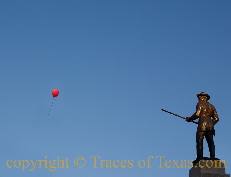 "Title: Statue vs. Balloon<br /> <br /> Comments: Just kind of looking through my lens at this statute on the state capitol grounds and thinking ""that's pretty boring""  when this red balloon drifted past. Who knows how it got there or who released it or where it came from? All I know is that, for about 1.5 seconds, it made for a funny photo. <br /> <br /> Location:  Austin"