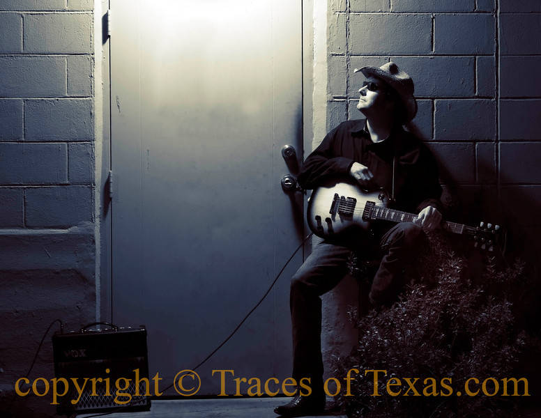 "Title:  Song for 13 Winds<br /> <br /> Comments: In an alleyway in downtown Austin, this old blues picker was taking a break. He told me that the song he had just finished playing was ""Mozart's Serenade for 13 Winds,  but in a minor blues key instead of B flat major."" ...<br /> <br /> OOOOOOH-Kay. <br /> <br /> Location: Austin"