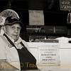 """Title: Barbecue Zen Master<br /> <br /> Comments.  I took this photo of Texas barbecue legend Vencil Mares at his barbecue place, the Taylor Cafe. Mr. Mares is 88 years old and a World War II veteran of the Normandy landing (D-day), the Battle of the Bulge, and the Battle of Bastogne. He served as a medic, then came back to Texas and has been cooking barbecue for the last 65 years. I asked him what the secret to his long life is and he smiled and said """"barbecue is health food."""" He's a Texas treasure, rightly revered, and it was good to see him holding court. <br /> <br /> Location: Taylor"""
