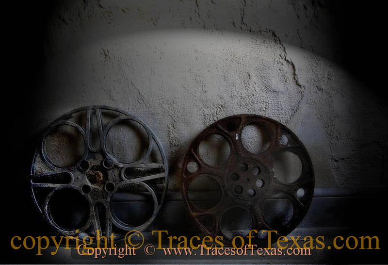 Title:   Reel Old <br /> <br /> Comments: In the projection booth of the old Arcadia Theater in Temple, two rusting film reels just .... fade .... away. <br /> <br /> Location: Temple