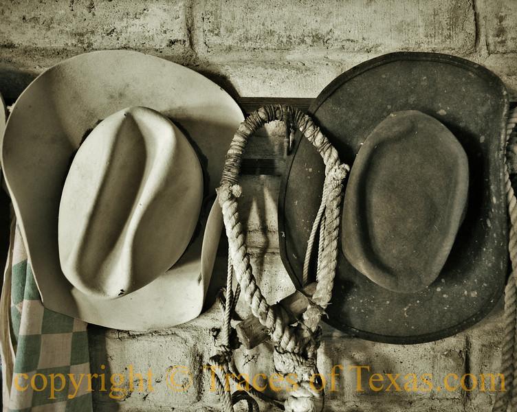 Cowboy hats and lariat.