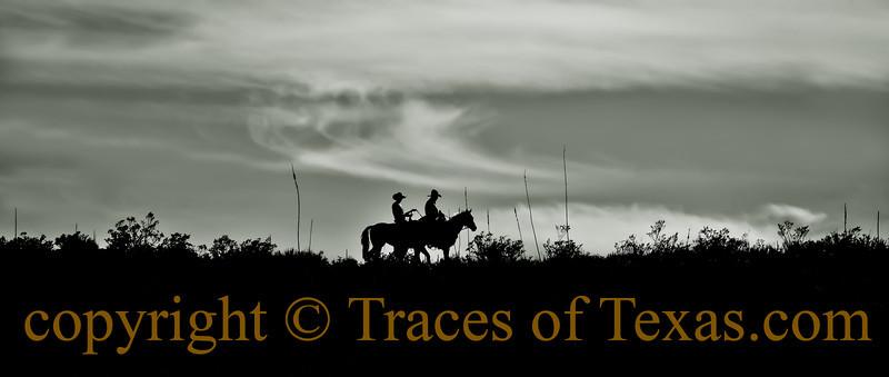 Two cowboys, spooky feel.