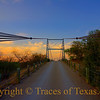 "Title: Across the Great Divide<br /> <br /> Comments: If you've ever seen ""The Texas Country Reporter,""  you've seen this bridge.  It's shown during the introduction with Bob Phillips, the host, driving across it as the sun rises. It is WAY off the beaten path, in Regency, Texas.  <br /> <br /> Location: Regency"