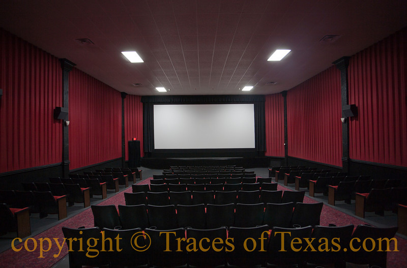 """<br>Title: Waiting for the Show  Comments: It seems that small-town Texas movie theaters have one of two destinies: either they go belly-up, """"Last Picture Show"""" style, or they find an investor, get refurbished, hang on, and compete with the big city megaplexes. There seems to be no in-between. The Cole Theater is an example of the second type: it still retains its vintage looks on the outside but has been retrofitted on the inside, offering a state-of-the-art movie experience in an old cinema setting.  I have a nostalgia for the old theaters, of course, so I'm always glad to find one that has managed to remain in business.   Location: Halletsville"""