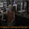 Title: I Promise You She is the Nicest Lady in Texas<br /> <br /> Comments: Linda is the barkeep at Mynars bar, one of the best watering holes in Texas. The bar has been in her family since the 1930's. The wooden floors are worn as smooth as ivory. <br /> <br /> Location: West