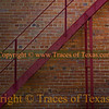 Title:   1734 Shades of Red<br /> <br /> Comments: An alleyway fire escape study in shades, shapes and angles. <br /> <br /> Location:Nacogdoches, Texas