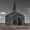 Title:   Little Church on the Plain <br /> <br /> Comments: Black and white version. I was driving between Gasoline, Texas and Paducah, Texas when I came around a corner and saw this church literally in the middle of nowhere, with no town around it. <br /> <br /> Location: