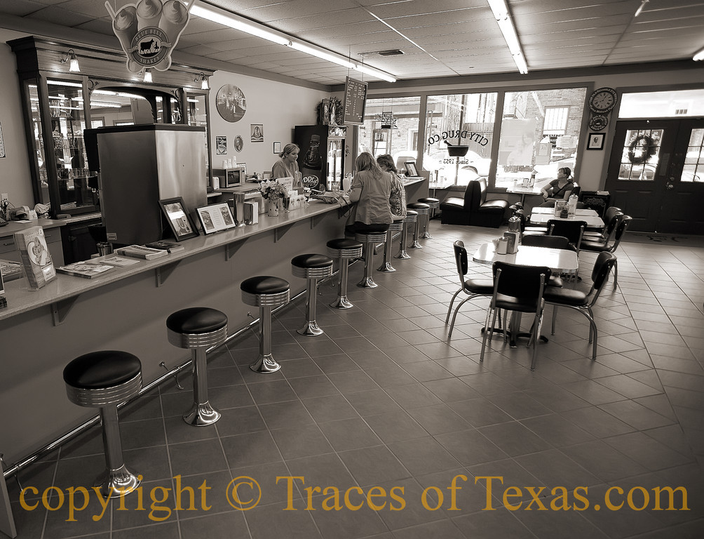 <br>Title: Photographs and Memories  Comments:  After 60 years, the soda fountain at the City Drug Store is still going strong. They made me a cherry limeade that knocked my socks off. I actually saw God for a moment or two.   Location: Jefferson