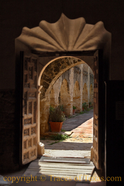Title:   Dear Abbey, Dear Abbey<br /> <br /> Comments: This scalloped door leads from the transept to the arched walkway in Mission San José y San Miguel de Aguayo.<br /> <br /> Location: San Antonio, Texas