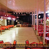 Title:   Pressed Tin <br /> <br /> Comments: With Its pressed tin ceiling and red vinyl tablecloths, the Cotton Club dance hall waits for the dancers to arrive.<br /> <br /> Location:  Granger