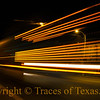 Title:  I Believe We Got Us a Convoy<br /> <br /> Comments:  The blurred lights of an 18-wheeler rumbling through Brady late at night. <br /> <br /> Location:  Brady