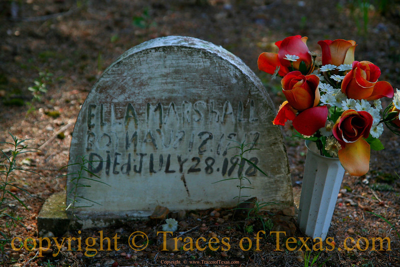 Title:   Ella Marshall <br /> <br /> Comments: In a rural black cemetery, the memory of Ella Marshall is preserved.<br /> <br /> Location: West Point, Texas
