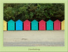 Colouful beach huts, there are about thirty of them in a row