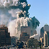 North Tower exploding on 9/11. Building 7 can be seen standing in the foreground.